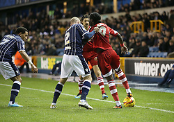 Millwall's Alan Dunne gets to grips early on with Middlesbrough's Marvin Emnes - Photo mandatory by-line: Robin White/JMP - Tel: Mobile: 07966 386802 21/12/2013 - SPORT - FOOTBALL - The Den - Millwall - Millwall v Middlesbrough - Sky Bet Championship