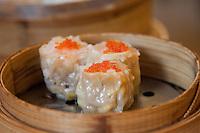 chinese dim sum in steam basket in a restaurant in shanghai