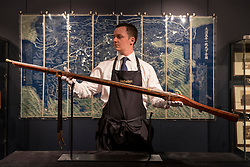 "© Licensed to London News Pictures. 03/11/2016. London, UK.  A staff member shows ""Supreme Number One"", the first Chinese imperial firearm to be offered at auction, created for the Qianlong Emperor of the Manchu Qing dynasty, est. GBP1-1.5m, at the preview of Chinese artworks entitled ""Treasures Of The Song & Qing Dynasties"" to be auctioned at Sotheby's in November.   Photo credit : Stephen Chung/LNP"