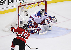 May 21, 2012; Newark, NJ, USA; New Jersey Devils center Travis Zajac (19) scores a goal on New York Rangers goalie Henrik Lundqvist (30) during the first period in game four of the 2012 Eastern Conference Finals at the Prudential Center.
