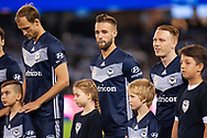 Melbourne Victory lines up with juniors at the Hyundai A-League Round 1 soccer match between Melbourne Victory and Melbourne City FC at Marvel Stadium in Melbourne.