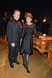 VISCOUNT LINLEY and JOANNA WOOD at a party to celebrate the publication of Interiors For Living by Joanna Wood held at Christie's. 8 King Street, St.James's, London on 2nd March 2015.