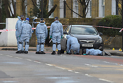 © Licensed to London News Pictures 22/01/2018, London,UK. Forensic search teams in Romford road, Stratford, after a 21 year male was shot on Sunday night, Photo credit: Steve Poston/LNP
