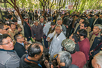 Shanghai, China - April 7, 2013: group of people discussing in fuxing park at the city of Shanghai in China on april 7th, 2013