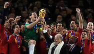 Spain's goalkeeper Iker Casillas (C-L) raising the trophy handed to him by FIFA President Sepp Blatter (4thR) and South Africa's President Jacob Zuma (3rdR) as Spain's national football team players celebrate winning the 2010 World Cup football final Netherlands vs. Spain , at Soccer City stadium, in Johannesburgo, South Africa, on July 11, 2010.   (Alejandro Pagni/PHOTOXPHOTO).
