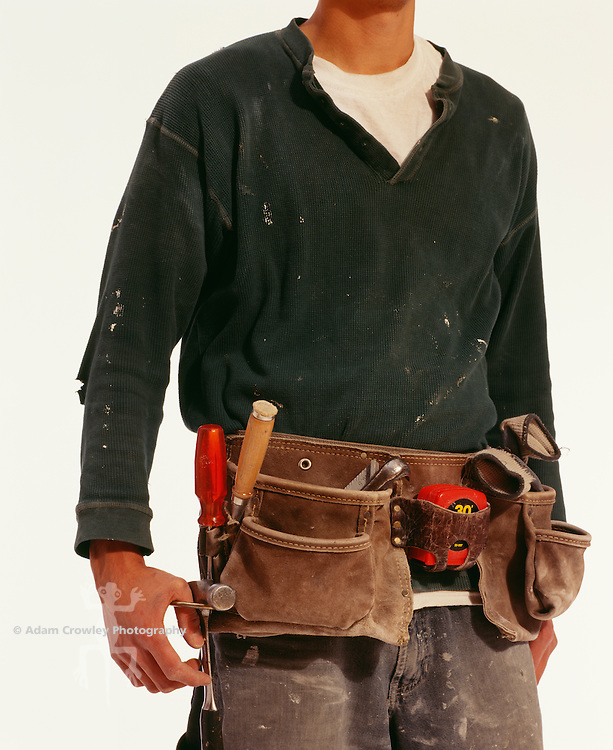 Carpenter wearing tool belt, mid section