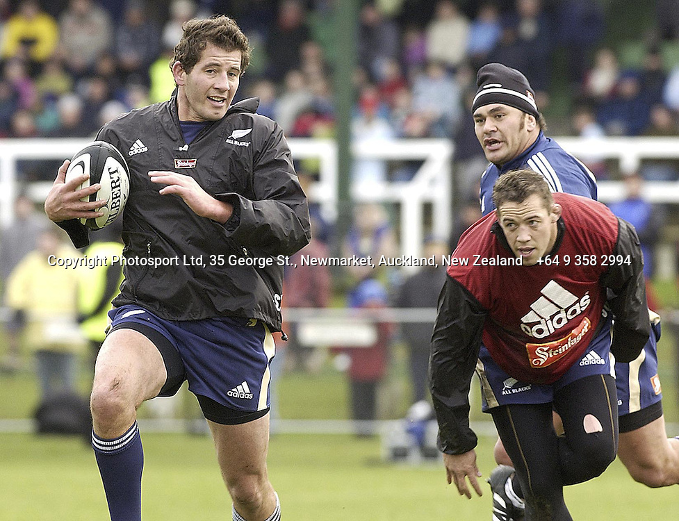 Simon Maling is chased by Jono Gibbes during an All Black Training, 07 June 2004 in Dunedin, prior to the Test match against England on Saturday.<br />Please credit: Photosport