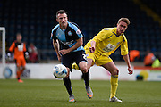 Wycombe midfielder Garry Thompson and Accrington defender Tom Davies during the Sky Bet League 2 match between Wycombe Wanderers and Accrington Stanley at Adams Park, High Wycombe, England on 30 April 2016. Photo by David Charbit.