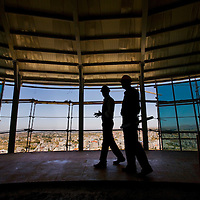Two Palestinians ingeniors inspect the top floor of the Palestine tower meant to be a high end retaurant built with a rotating floor a Ramallah...Photo: Olivier Fitoussi pour Liberation