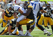 September 4 2010: Eastern Illinois Panthers quarterback Brandon Large (10) is sacked by Iowa Hawkeyes defensive tackle Lebron Daniel (58) during the fourth quarter of the NCAA football game between the Eastern Illinois Panthers and the Iowa Hawkeyes at Kinnick Stadium in Iowa City, Iowa on Saturday September 4, 2010. Iowa defeated Eastern Illinois 37-7.