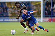 AFC Wimbledon attacker Shane McLoughlin (19) getting fouled during the Pre-Season Friendly match between AFC Wimbledon and Crystal Palace at the Cherry Red Records Stadium, Kingston, England on 30 July 2019.