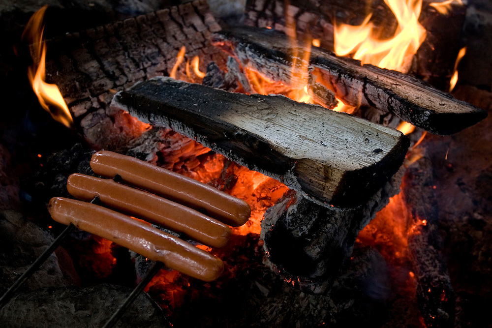 A campfire cooks hot dogs at a campground along the Salmon River in White Bird, Idaho, on June 15, 2011. (Photo by Geoff Hansen)