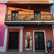 SAN JUAN, PUERTO RICO -- JANUARY 1, 2019: <br /> Tourists  walk on  Calle San Sebastian in Historic Old San Juan. This street is where the legendary Carnival de la Calle San Sebastian is held every year.<br /> (Photo by Angel Valentin)