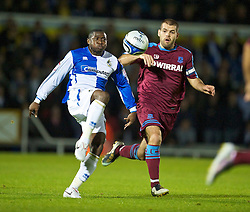 BRISTOL, ENGLAND - Tuesday, September 28, 2010: Tranmere Rovers' John Welsh and Bristol Rovers' Jo Kuffor during the Football League One match at the Memorial Ground. (Photo by David Rawcliffe/Propaganda)