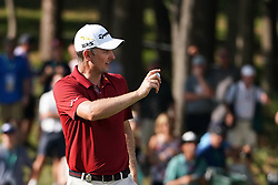 August 9, 2018 - St. Louis, Missouri, United States - Justin Rose waves to the crowd after putting during the first round of the 100th PGA Championship at Bellerive Country Club. (Credit Image: © Debby Wong via ZUMA Wire)