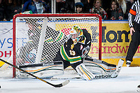 KELOWNA, CANADA - JANUARY 26: Andy Desautels #33 of the Prince Albert Raiders does the splits and blocks the net at the Kelowna Rockets on January 26, 2013 at Prospera Place in Kelowna, British Columbia, Canada (Photo by Marissa Baecker/Shoot the Breeze) *** Local Caption ***
