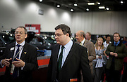 ..Dr. Stephen Farry Employment and Learning Minister for Northern Ireland is shown around  the ExCel Centre with entourage  in London on October 8th 2011.