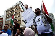 Frankfurt am Main | 24 July 2014<br /> <br /> Am Donnerstag (24.07.2014) demonstrierten etwa 150 Menschen aus linksradikalen und migrantischen Zusammenh&auml;ngen in Frankfurt am Main auf der Einkaufsstra&szlig;e Zeil gegen die israelischen Angriffe auf Pal&auml;stina und Gaza.<br /> Hier: M&auml;nner mit Pal&auml;stina-Flaggen und einem Plakat mit der Aufschrift &quot;Blaming the palestinian military brigades for the resistance is like blaming a woman for fighting rapist&quot;.<br /> <br /> Photo &copy; peter-juelich.com