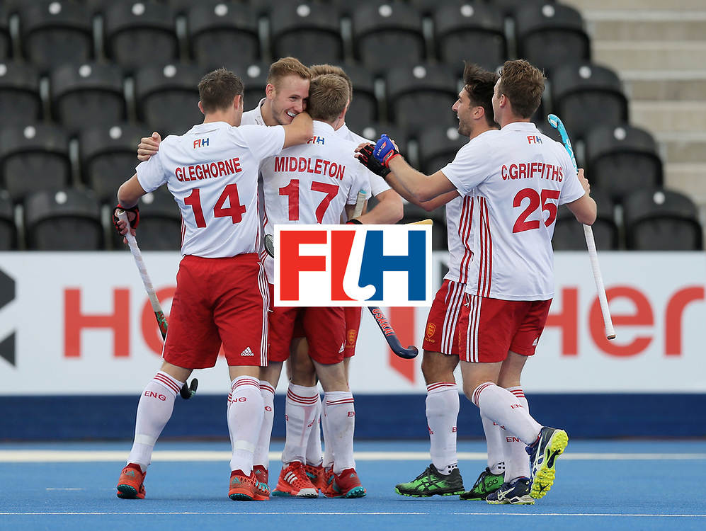 LONDON, ENGLAND - JUNE 25:  David Ames of England celebrates scoring their teams second goal with teammates during the 3rd/4th place match between Malaysia and England on day nine of the Hero Hockey World League Semi-Final at Lee Valley Hockey and Tennis Centre on June 25, 2017 in London, England.  (Photo by Alex Morton/Getty Images)