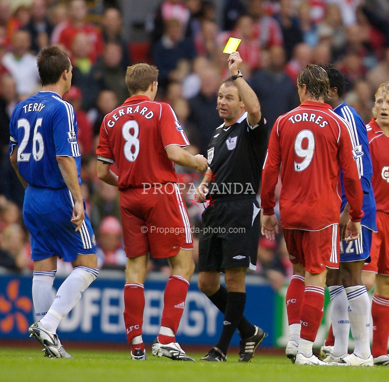 Liverpool, England - Sunday, August 19, 2007: Liverpool's Steven Gerrard MBE is shown the yellow card by referee Rob Styles despite being the victim of a dangerous challenge from a Chelsea player during the Premiership match at Anfield. (Photo by David Rawcliffe/Propaganda)