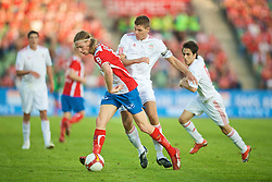 OSLO, NORWAY - Wednesday, August 5, 2009: Liverpool's captain Steven Gerrard MBE in action against FC Lyn Oslo's Jo Inge Berget during a preseason match at the Bislett Stadion. (Pic by David Rawcliffe/Propaganda)