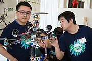 Huafeng Liu, right,  explains the tricopter design his team built to his classmates, Bingxing Xu, left and An Liu, center, at the annual Student Research and Creative Activity Expo at Ohio University.  More than 800 participants from 56 departments and schools took part in the event. Photo by Ohio University / Jonathan Adams