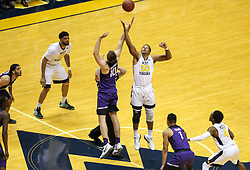 Feb 12, 2018; Morgantown, WV, USA; West Virginia Mountaineers forward Sagaba Konate (50) and TCU Horned Frogs forward Vladimir Brodziansky (10) jump for the tip at WVU Coliseum. Mandatory Credit: Ben Queen-USA TODAY Sports