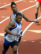 05/14/2009 - Grant's Karl Acker takes the baton from teammate Duante Paschel (492) on their way to winning the men's 4x100 meter relay race. The 6A PIL Varsity District Track Meet takes place at Lewis and Clark College....KEYWORDS:  City, Portland, sports, high school, state, boys, girls