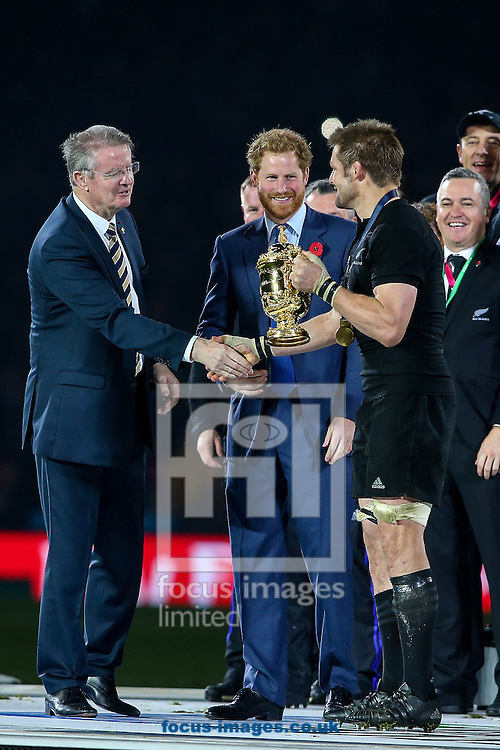 Richie McCaw of New Zealand (right) is congratulated by Bernard Lapasett, (left) Chairman of World Rugby and HRH Prince Harry during the final of the 2015 Rugby World Cup at Twickenham Stadium, Twickenham<br /> Picture by Andy Kearns/Focus Images Ltd 0781 864 4264<br /> 31/10/2015