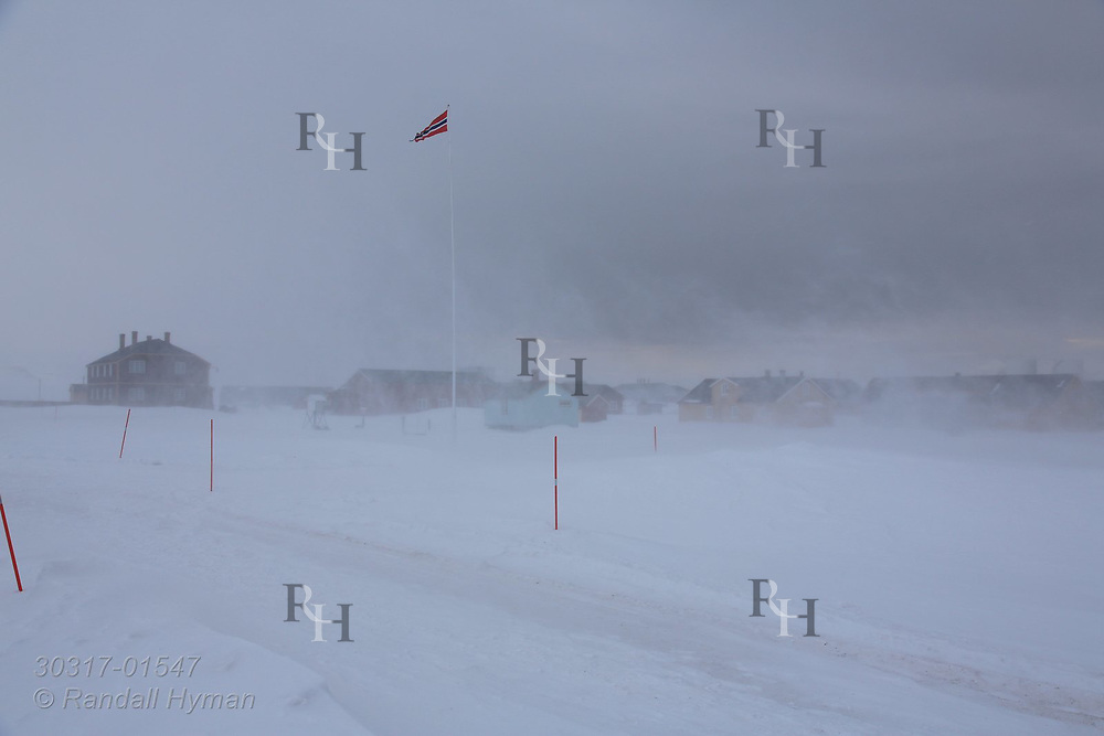 Heavy April winds blow snow at the international science village of Ny-Alesund on Spitsbergen island in Kongsfjorden; Svalbard, Norway.
