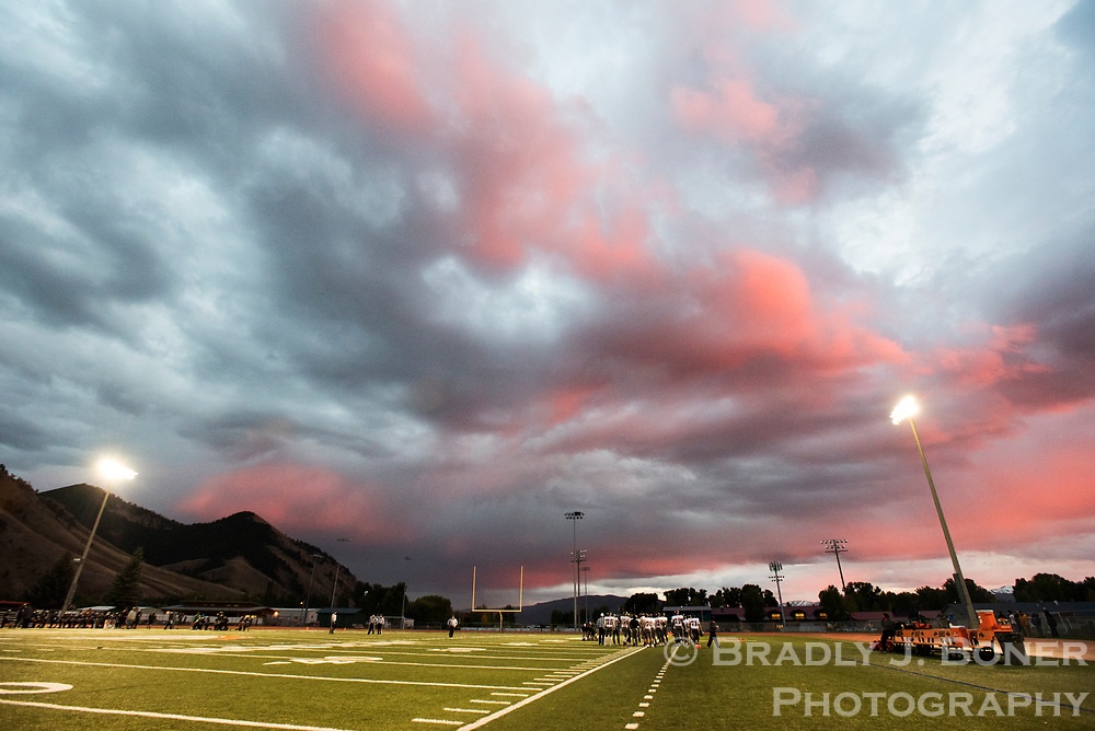 Sunset spreads across the evening sky during a break in the action of the Jackson Broncs' football game against Worland on Friday night.