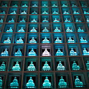 TOKYO, JAPAN - JULY 7 : Glass Buddha alters are lit up in Koukokuji temple on July 7, 2016 in Tokyo, Japan. Operated by the Koukokuji buddhist temple, The Ruriden columbarium at the Koukoko-ji Temple houses over 2,046 crystal Buddha statues, each illuminated by high-powered LED lights. Behind each Buddha is a drawer storing people's ashes. An IC card allows the owner of the alter to access the building and lights up the corresponding statue. The ashes are stored for 33 years before being buried below the Ruriden, currently 900 alters are in use as of July 2016. (Photo: Richard Atrero de Guzman/NUR Photo)