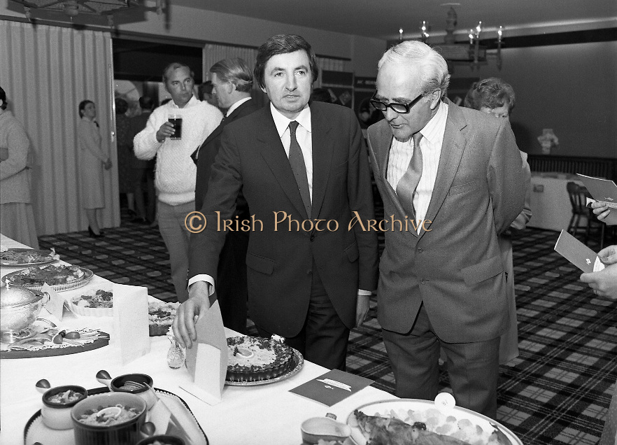 """The National Fish Cookery Award""..29.04.1982..04.29.1982.29th April 1982.1982...This competition sponsored by Bord Iascaigh Mhara was held in The Clare Inn, Newmarket-on Fergus,Co Clare. the competition was open to schools across the country.. The Minister for Fisheries and Forestry, Mr Brendan Daly and Mr T F Geoghegan, Market Development Manager, Bord Iascaigh Mhara, view the entries."