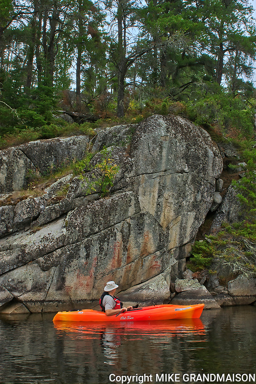 Kayaking on Blindfold Lake by the cliffs<br />Kenora DIstrict<br />Ontario<br />Canada