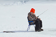 Middletown, New York - A young boy ice fishes at the Shawangunk Fish and Game Association pond during the association's annual contest on Feb. 8, 2014. ©Tom Bushey / The Image Works