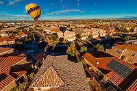 Hot air balloons landing in a residential area during the Albuquerque International Balloon Fiesta, Albuquerque, New Mexico USA.