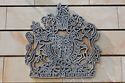 Royal Coat of Arms of the United Kingdom of Great Britain and Northern Ireland, the official coat of arms of the British monarch, on the exterior wall of the British Embassy, the United Kingdom's diplomatic mission to Germany in Berlin. It is located on 70-71 Wilhelmstraße, near the Hotel Adlon. Upon reunification in 1991, an architectural competition was won by Michael Wilford and the new building opened by Queen Elizabeth II on 18 July 2000..