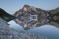 Mount Regan mirrored in still waters of Sawtooth Lake, Sawtooth Mountains Wilderness Idaho