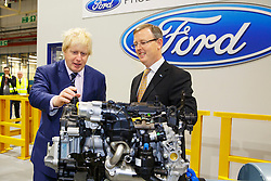 © Licensed to London News Pictures. 25/11/2014. LONDON, UK. Boris Johnson is briefed by Martin Everitt, Dagenham Plant Manager as Mayor of London visits the Ford Dagenham engine plant in east London on Tuesday, 25 November 2014. The Mayor of London is given a tour of the company's new high-tech engine assembly line and briefed about Ford's £475m in the site, which made it one of the biggest and longest-established factories of its kind in Europe. Photo credit : Tolga Akmen/LNP
