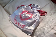 Love bag on a honeymoon bed