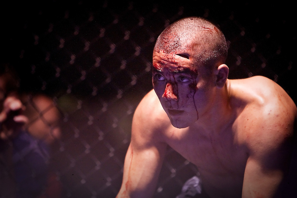 JEROME A. POLLOS/Press..Jon Katayama waits for the fight doctor to inspect the gash on his head he received during his featherweight bout with Jeremiah Bunch during Friday's Professional Fighting Association's cage matches at North Idaho College.