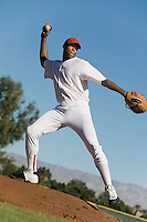 Baseball pitcher throwing ball during game