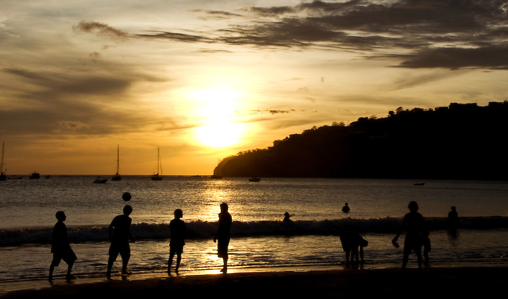 A Nica boy heads a soccer ball to his teammate in a match of beach futbol in San Juan Del Sur, Nicaragua.