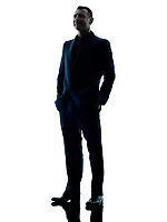 one caucasian business man standing silhouette isolated on white background