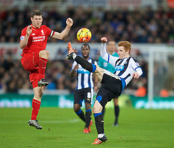 NEWCASTLE-UPON-TYNE, ENGLAND - Sunday, December 6, 2015: Liverpool's James Milner in action against Newcastle United's Jack Colback during the Premier League match at St. James' Park. (Pic by David Rawcliffe/Propaganda)