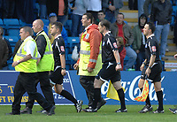 Photo: Ashley Pickering.<br /> Gillingham v Leeds United. Coca Cola League 1. 29/09/2007.<br /> The match officials are escourted off the ptich after two Leeds players are sent off during the game