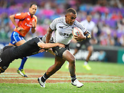 Fijian player Eroni Sau try to break a tackle during the game Fiji vs New Zealand All Blacks during the Cathay Pacific/HSBC Hong Kong Sevens festival at the Hong Kong Stadium, So Kon Po, Hong Kong. on 7/04/2018. Picture by Ian  Muir.