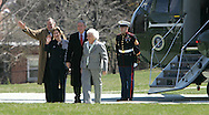 President George W.Bush and First Lady Laura Bush and  President H.W. Bush and Barbara Bush wave as they leave Marine One at the Naval Observatory to return to the White House.  Marine One landed at the Naval Observatory because the South Lawn on the White House is being prepared for the East Egg Roll on Monday, March 24, 2008. Photo by Dennis Brack/Black Star