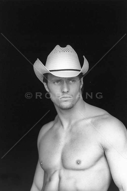 handsome cowboy outdoors without a shirt
