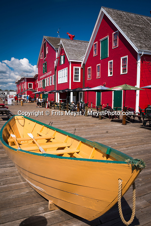 """Lunenburg, Nova Scotia, Canada, August 2014. Old Town Lunenburg is one of only two urban communities in North America designated as a UNESCO World Heritage site. Considered to be the best surviving planned British colonial town in North America, you can still see the tall ships moored off the port. Nova Scotia was one of the original four provinces that became part of Canada in 1867.  """"Nova Scotia"""" is Latin for """"New Scotland"""", and Scottish settlers brought culture and traditions that continue to this day. Photo by Frits Meyst / MeystPhoto.com"""